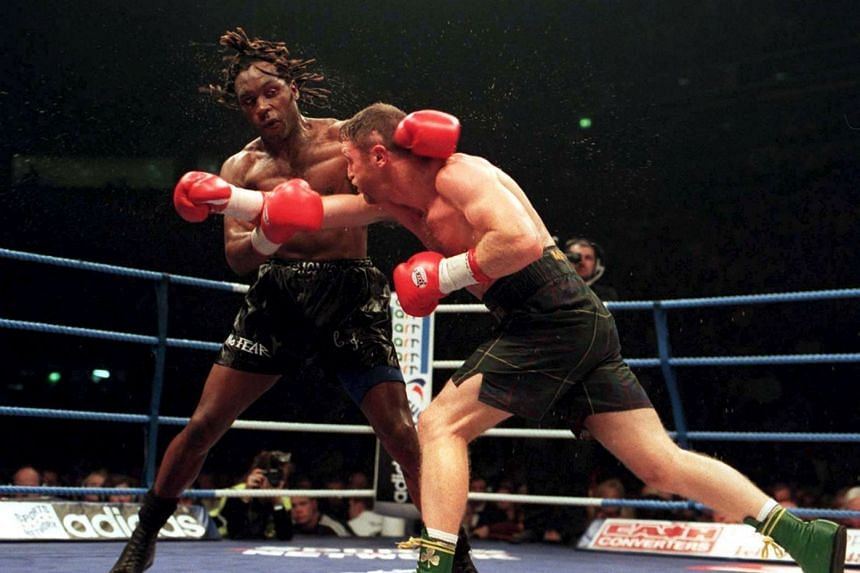 A 1996 photo shows Steve Collins throwing a punch as Nigel Benn trys to get out the way.