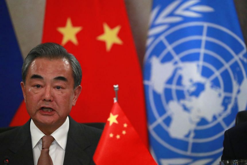 Chinese Foreign Minister Wang Yi speaks while hosting a lunch with his counterparts of the permanent five veto-wielding members of the UN Security Council.