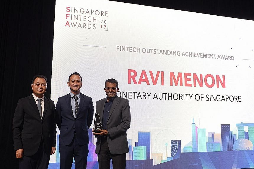 (From left) Bank of China chief information officer Liu Qiuwan and Singapore FinTech Association president Chia Hock Lai at the inaugural Singapore FinTech Awards yesterday, with Monetary Authority of Singapore managing director Ravi Menon, who recei