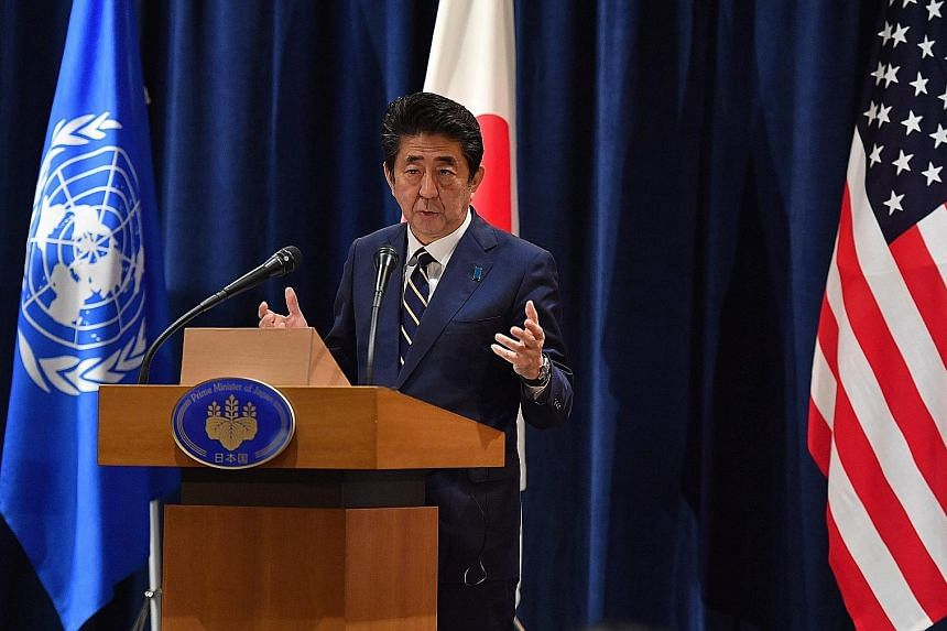 "Japanese Prime Minister Shinzo Abe at a press conference on the sidelines of the United Nations General Assembly in New York on Wednesday. He has described just-inked deals with the US as a ""win-win solution (that) will further galvanise investment b"
