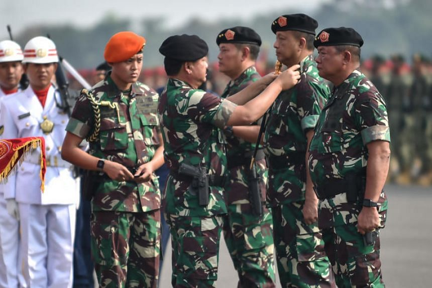 Indonesian military chief Marshal Hadi Tjahjanto (second, left) inaugurates (from right) Major-General Ganip Warsito, Air Vice-Marshal Fadjar Prasetyo and Rear-Admiral Yudo Margono during the inauguration ceremony of a three-defence territory joint c