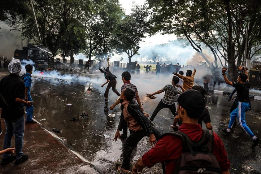 Indonesian students clash with police officers during a protest in Medan, Indonesia, on Sept 27, 2019. The demonstrations have been the biggest student protests since 1998.