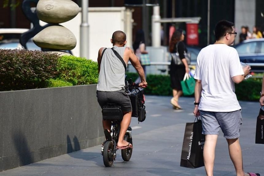 A personal mobility device user in Orchard Road on Sept 27, 2019.