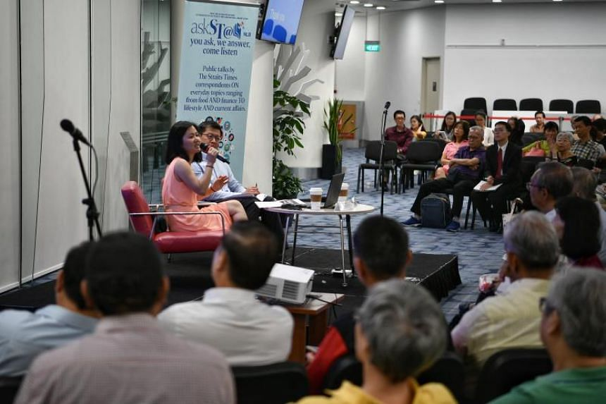 The Straits Times' senior political correspondent Tham Yuen-C and Singapore Management University law don Eugene Tan speaking at the askST@NLB at Singapore's Central Library on Sept 27.