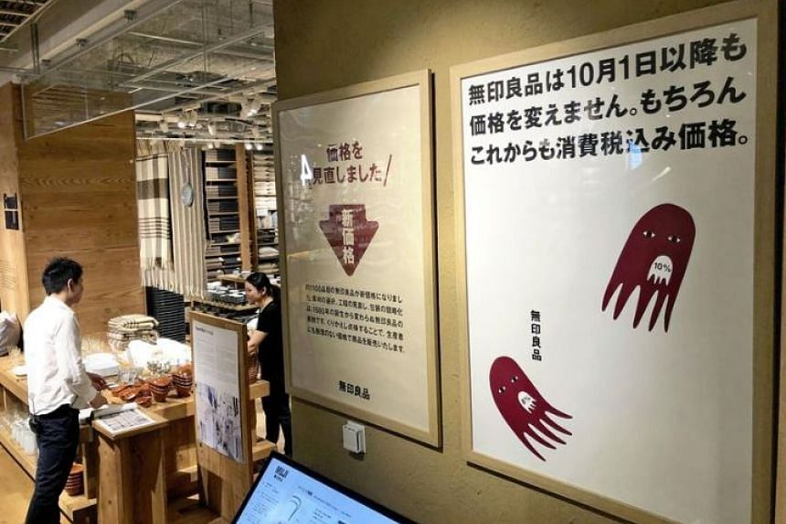 A poster at a Muji store in says  that prices will stay the same from October.