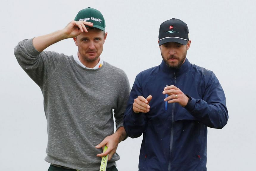 Singer Justin Timberlake (right) with England's Justin Rose during the second round.