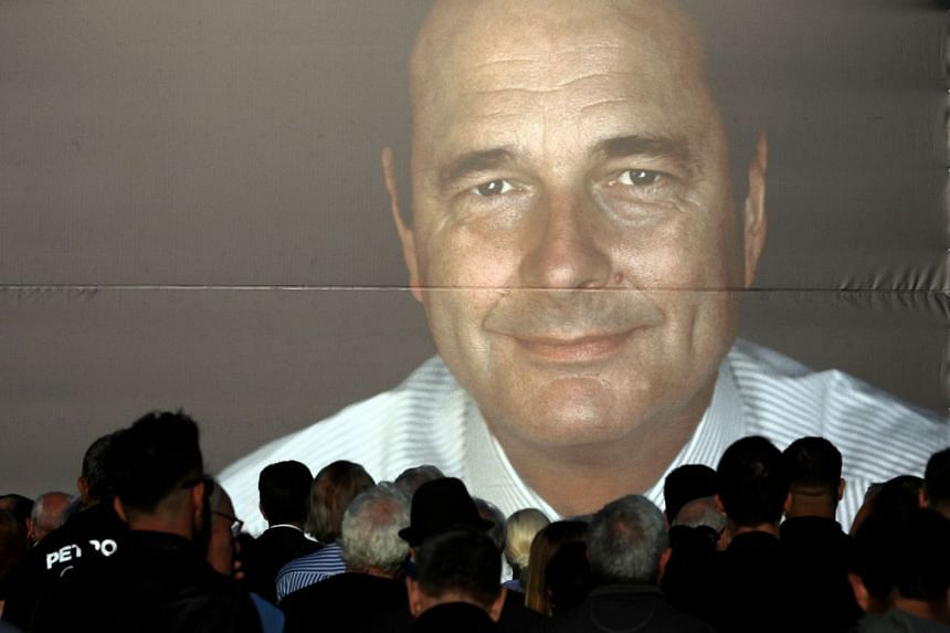 People gather to pay tribute to late former French president Jacques Chirac in Nice, France.