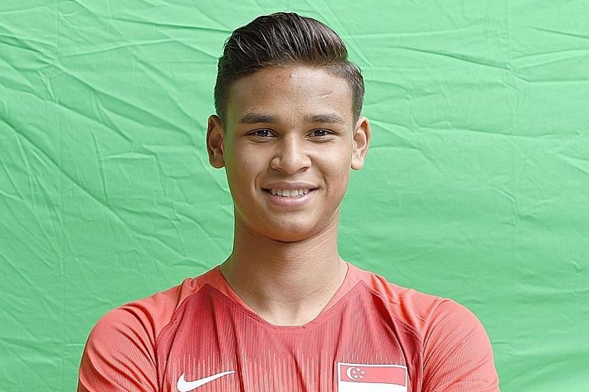 Right: Ilhan Fandi training at Geylang Field in Lorong 12 with the Young Lions. His father says that while he has the best technical abilities among the three oldest brothers, he is not as mature and developed at the same age as Irfan and Ikhsan. ST