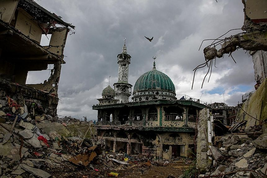 A mosque standing amid the ruins of the main battle area of Marawi City on Oct 25, 2017, after five months of intense fighting between Philippine government troops and ISIS-influenced fighters.
