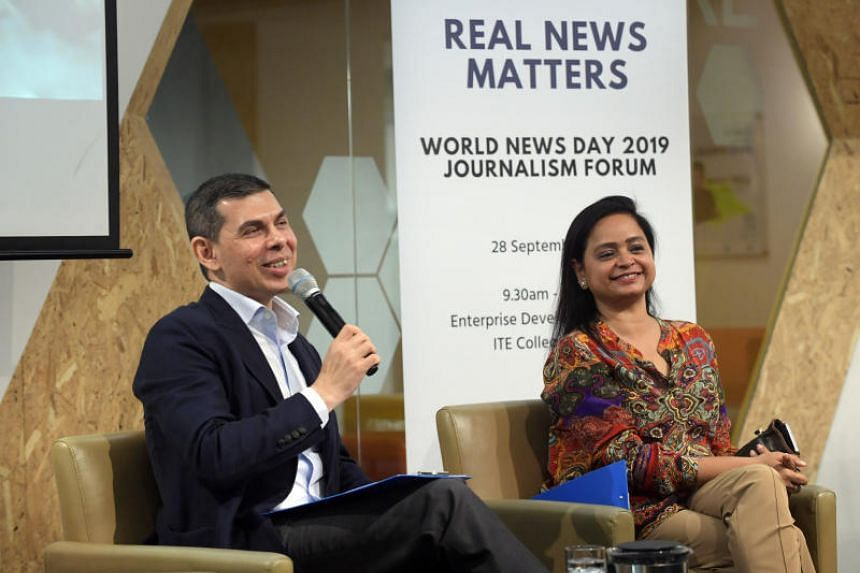 The Straits Times editor Warren Fernandez and ST's Asia News Network editor Shefali Rekhi at the Real News Matters journalism forum on Sept 28, 2019.