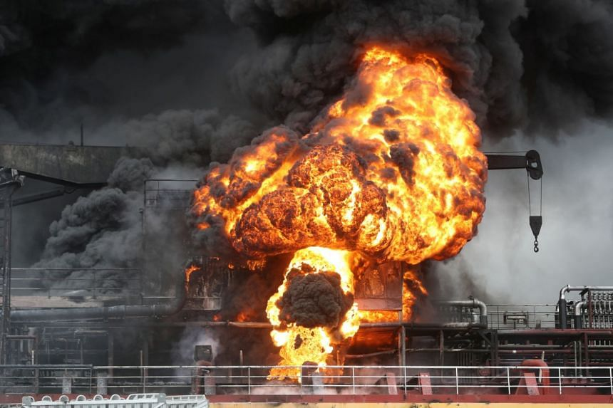 A column of fire and billowing black smoke was seen over the vessel in pictures published online.