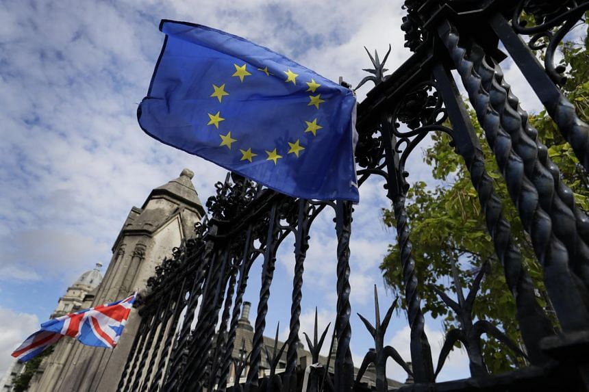 A European Union flag is tied on the railings of Britain's Parliament in London, on Sept 27, 2019.