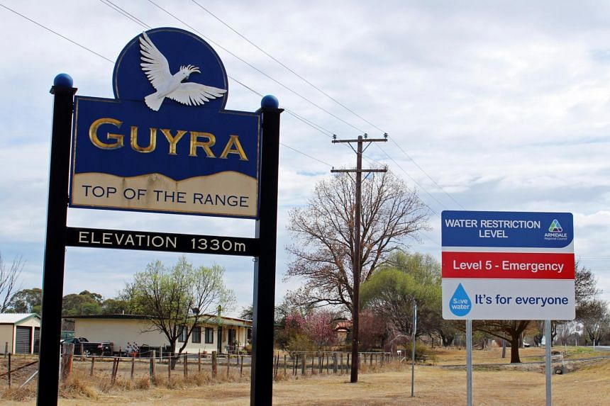 A sign indicating the water restriction level as a result of a drought in Guyra in rural Australia on Sept 25, 2019.