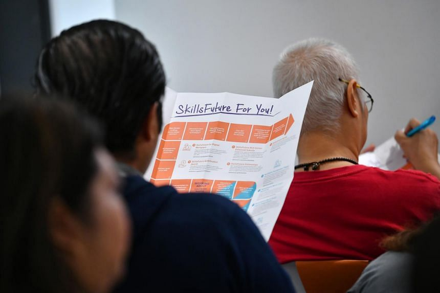 An employee listens to a presentation on SkillsFuture at Our Tampines Hub, on Aug 19, 2019.