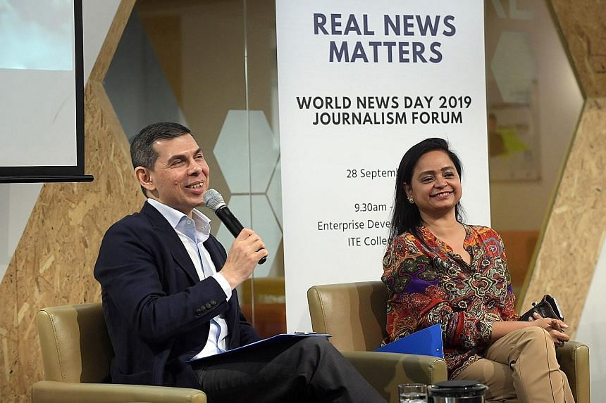 Mr Warren Fernandez, editor of The Straits Times, and Asia News Network editor Shefali Rekhi at the Real News Matters forum. ST PHOTO: ALPHONSUS CHERN