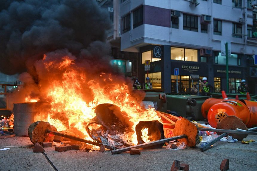 Protesters set a fire road block to slow police advancement at Wan Chai on Sept 29, 2019.