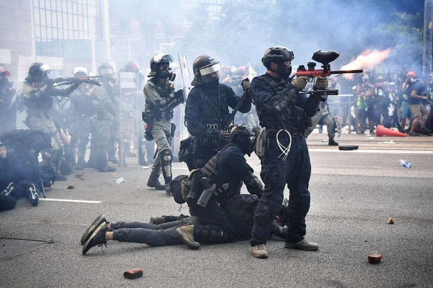 Police fire rubber bullets and tear gas at protesters near Lippo Centre, on Sept 29, 2019.