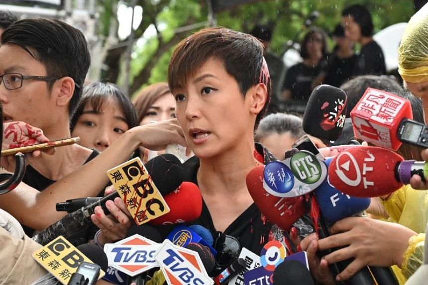Hong Kong singer and activist Denise Ho speaks to reporters after an unidentifiable person threw a red liquid at her while she was being interviewed outside the Parliament in Taipei on Sept 29, 2019.