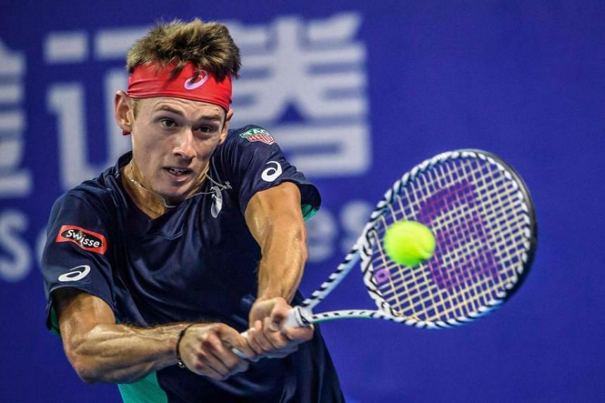 Alex de Minaur of Australia hits a return against Adrian Mannarino of France during their men's singles final match at the Zhuhai Championships tennis tournament in China's southern Guangdong province on Sept 29, 2019.