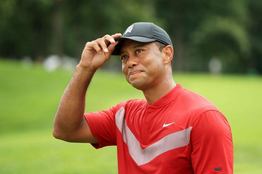 Woods reacts after finishing on the 18th green during the final round of the BMW Championship.