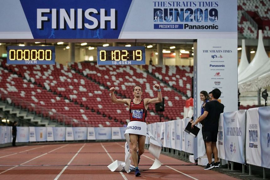 Nick Impey crossing the finish line of the 18.45km race at The Straits Times Run on Sept 29, 2019.