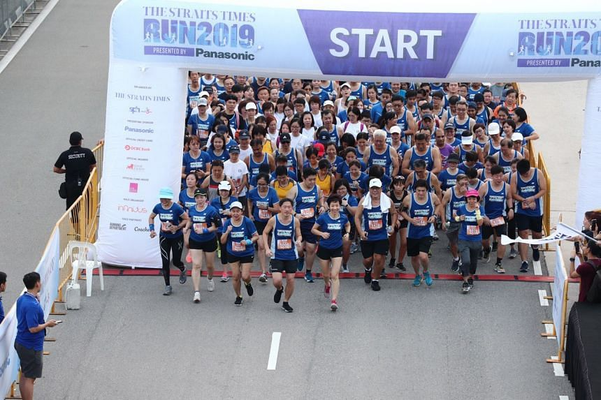 SPH deputy CEO Anthony Tan, and Culture, Community and Youth Minister Grace Fu taking part in the 3.5km Fun Run.
