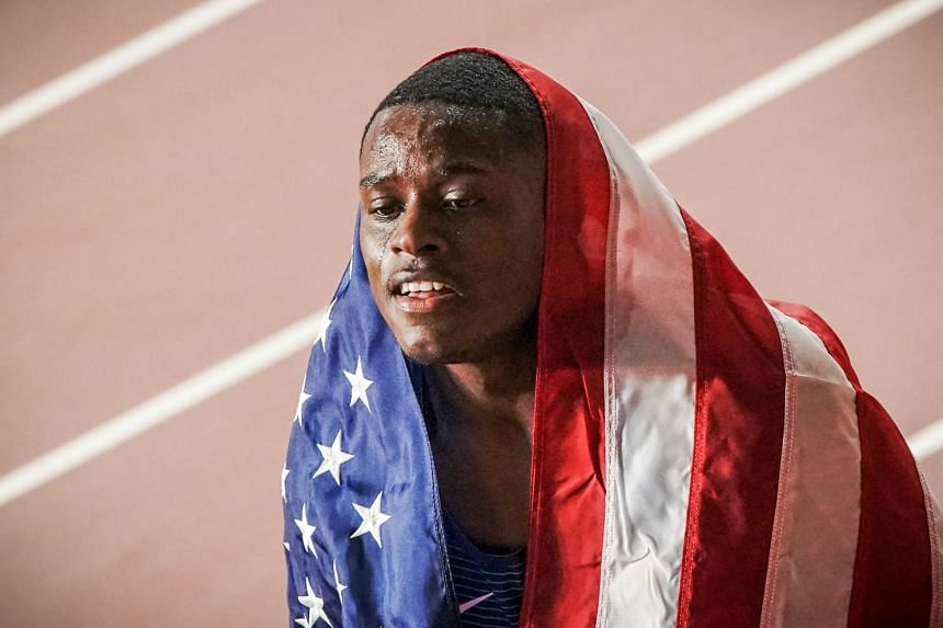 Christian Coleman celebrates his victory in the men's 100m final.