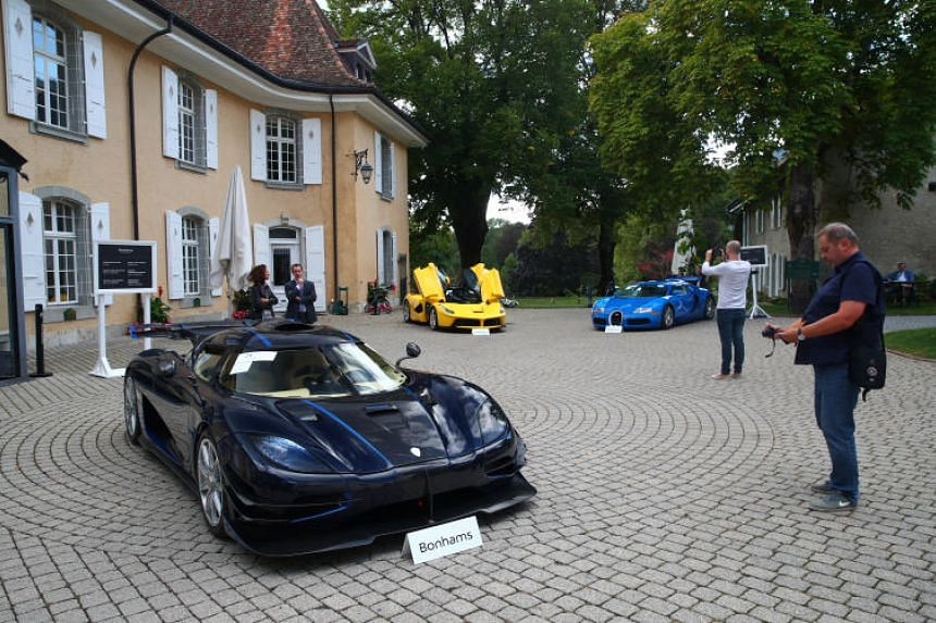 A view of some of the confiscated luxury cars being auctioned at the Bonmont Golf & Country Club in Cheserex near Geneva, Switzerland, on Sept 27, 2019.
