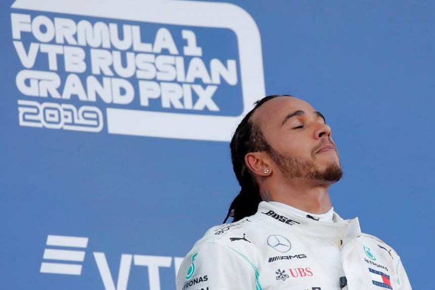Mercedes' Lewis Hamilton celebrates on the podium after winning the Russian Grand Prix on Sept 29, 2019.