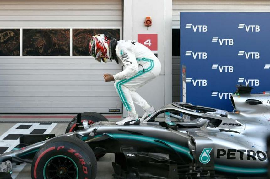 Mercedes' Lewis Hamilton celebrates on his car after winning the Russian Grand Prix on Sept 29, 2019.