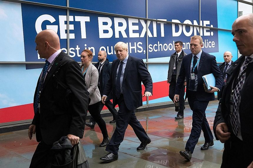 British Prime Minister Boris Johnson at Manchester Central on the opening day of the Conservative Party's annual conference yesterday. He is set to be spending considerable time on the phone with European leaders during the conference. PHOTO: BLOOMBE