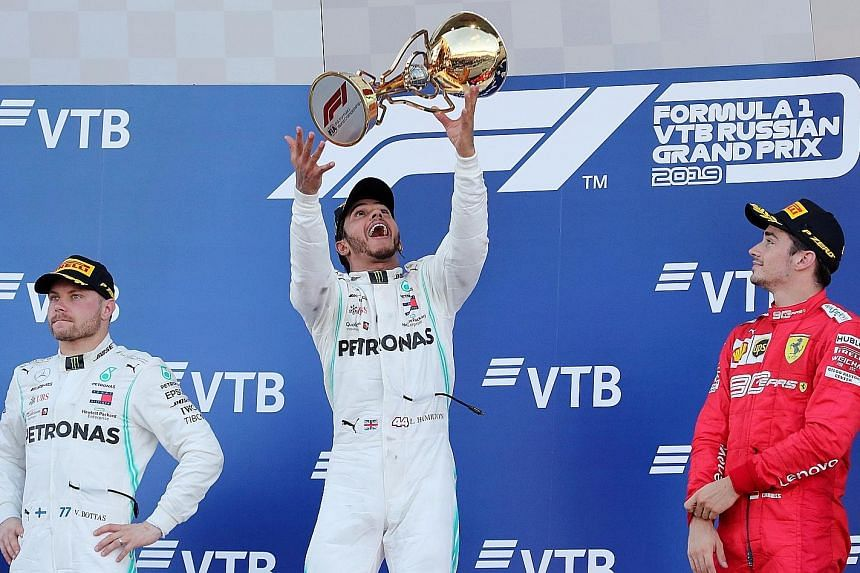 Lewis Hamilton tossing his winner's trophy on the podium, alongside Mercedes teammate Valtteri Bottas and third-placed Charles Leclerc, whose Ferrari team had won the last three races - prompting Hamilton to say that it felt like a long time since he last