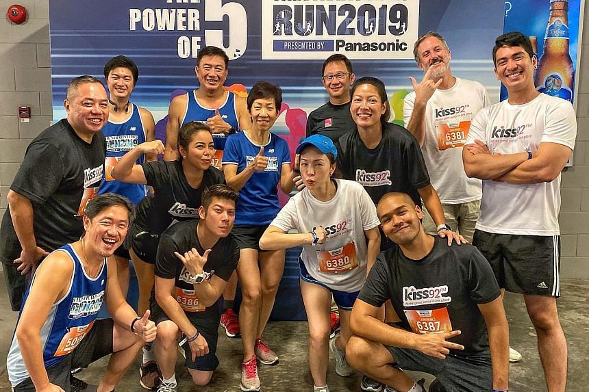 Powering up are (back row from left): Philip Chua, director of Panasonic Singapore's domestic business division; Lim Teck Yin Sport Singapore CEO; Lion Global Investors' chief marketing officer Lim Shyong Piau; and Kiss92 DJ Jason Johnson; (centre row fro
