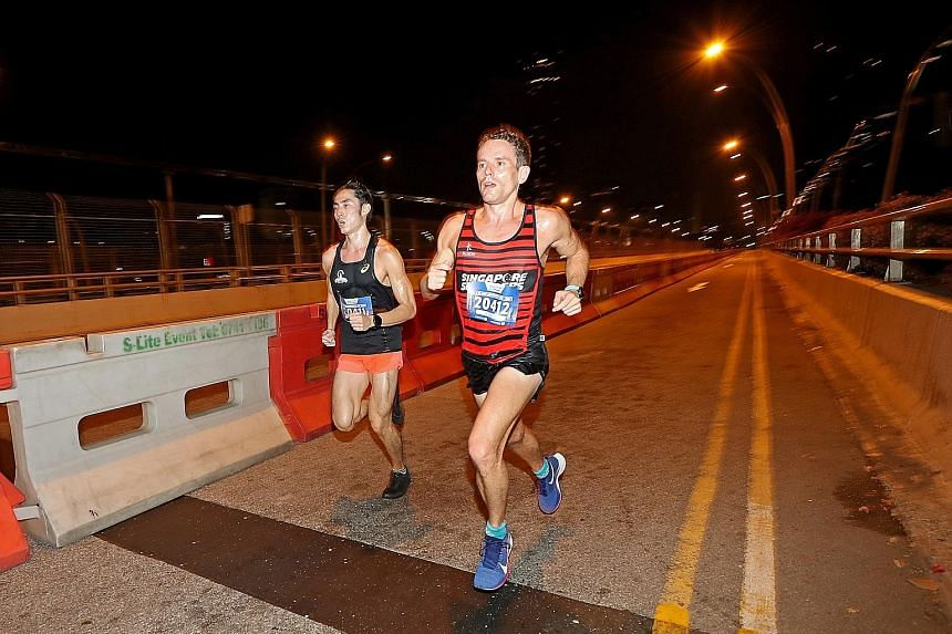 Soh Rui Yong and Nick Impey ran side by side throughout the ST Run 2019 yesterday morning - until the last stretch, when Impey powered ahead to win the race. Both runners bettered the 2018 winning time.