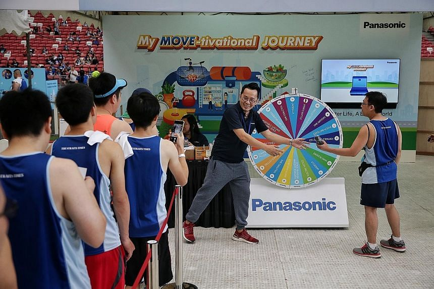 Participants queuing up to spin for prizes at Panasonic's game booth.