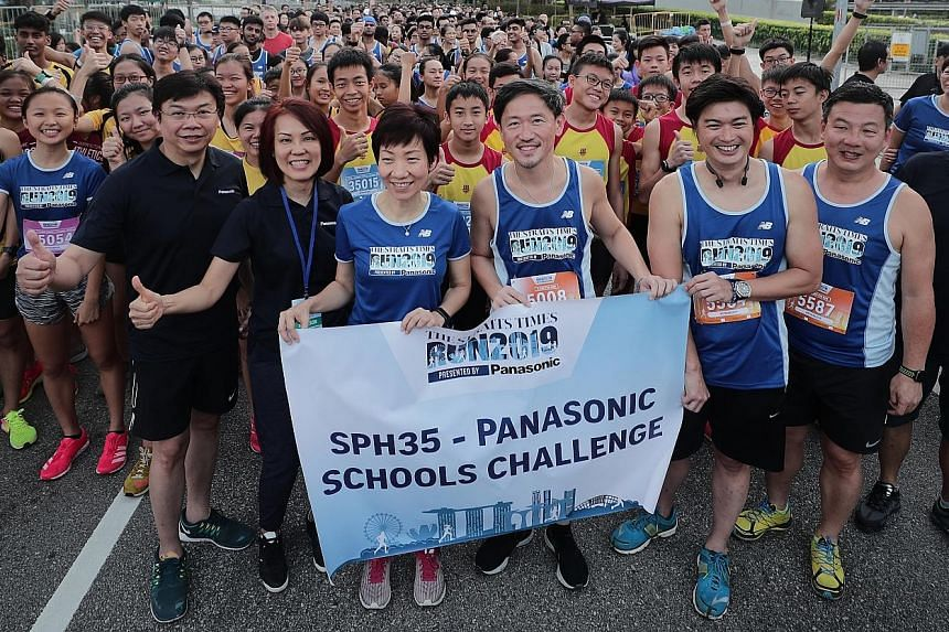 Minister for Culture, Community and Youth Grace Fu (third from left) at the start line of the SPH35-Panasonic Schools Challenge with (from left) Daniel Tan, Panasonic Singapore's director, regional business division; Joanne Ng, general manager of Panasoni