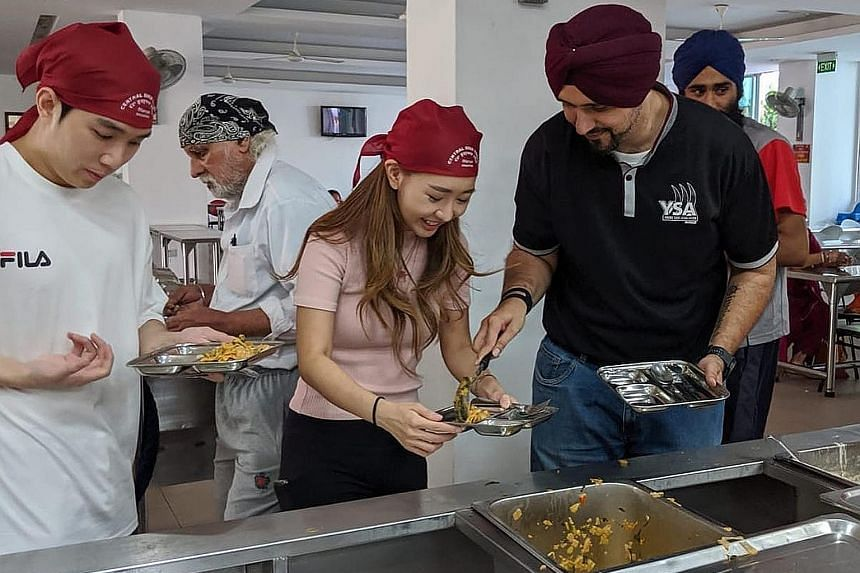 Instagram user Sheena Phua with Mr Sarabjeet Singh, president of the Young Sikh Association, during her visit to the Central Sikh Temple in Towner Road yesterday. She was invited to a gurdwara so she could learn more about Sikh traditions.