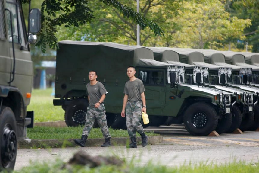 A photo taken on Aug 29 shows troops at the Shek Kong military base of China's People's Liberation Army, in New Territories, Hong Kong.