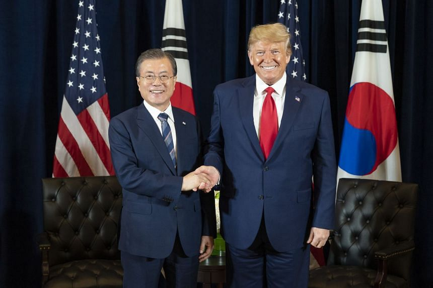 US President Donald Trump (right) shakes hands with South Korean President Moon Jae-in during their meeting on the sidelines of the United Nations General Assembly, on Sept 23, 2019.