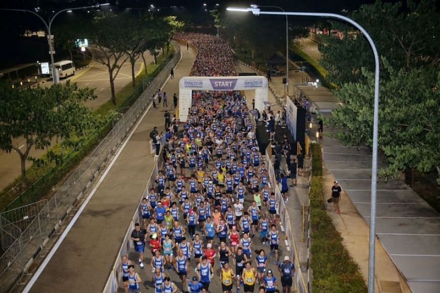 Participants at the start of the 18.45km race (first wave) of The Straits Times Run along Nicoll Highway before the break of dawn, on Sept 29, 2019.