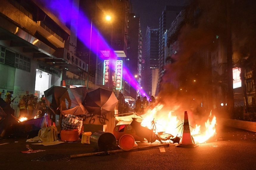 Anti-government protesters set a fire to road block near Causeway Bay, Hong Kong, on Sept 29, 2019.
