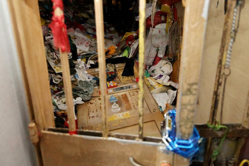 When The Straits Times visited the house on Sept 30, 2019, a chain held shut the metal gate at the entrance. But the main door was lying on piles of things the man had hoarded over the years.