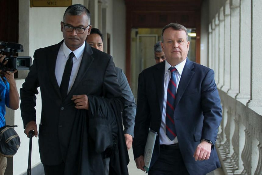 David Cope (right), head of financial crime compliance for Goldman Sachs Asia, arrives at the Kuala Lumpur Magistrate's Court on Sept 30, 2019. Malaysia is seeking to move the 1MDB-linked case against Goldman Sachs Group Inc to a higher court.