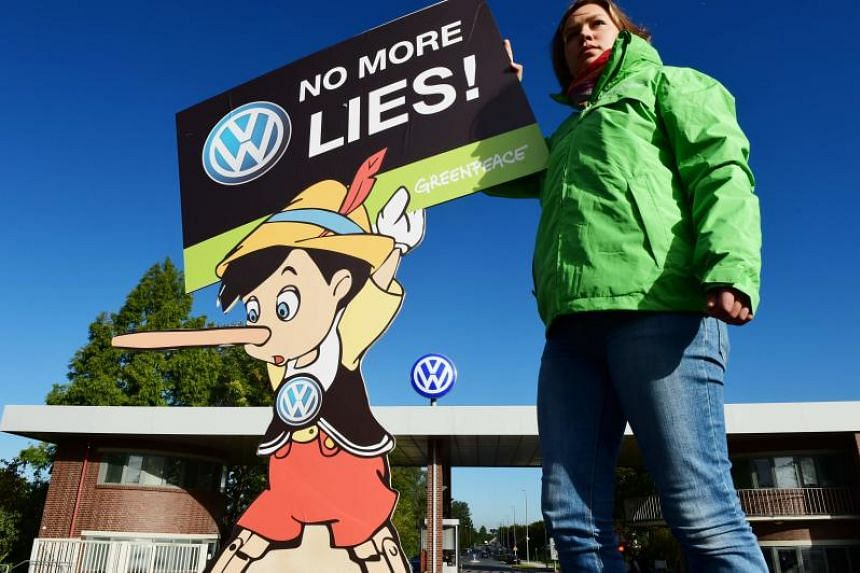 In a photo taken on Sept 25, 2015, an activist protests in front of Volkswagen's headquarters in Wolfsburg, Germany.