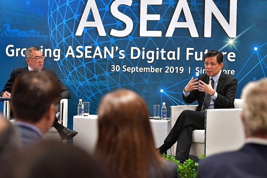 Minister for Trade and Industry Chan Chun Sing in a dialogue moderated by Mr Chia Kim Huat, regional head of corporate and transactional practice at Rajah & Tann, at the Digitise Asean conference yesterday.
