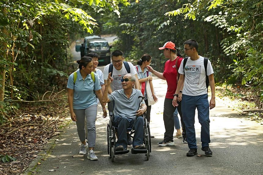 Mr Lai Gee with Home Nursing Foundation chief executive officer Christina Tiong (left), and Accessible Ubin founders Colin Chew (pushing Mr Lai's wheelchair) and Albert Liu (right).