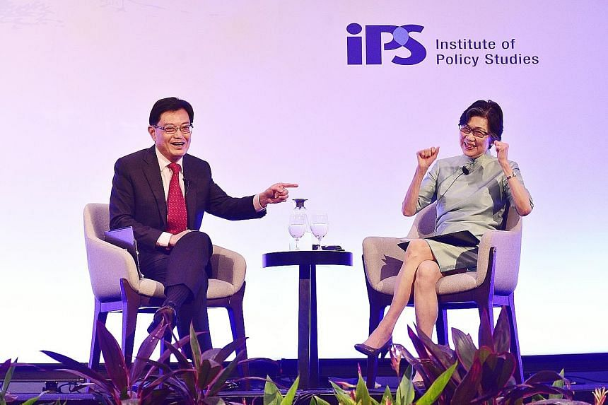 """Ambassador-at-Large Chan Heng Chee, who moderated the dialogue with Deputy Prime Minister Heng Swee Keat, showing her delight after Mr Heng corrected her and said she was not an """"oldie"""" when she referred to herself as such. Mr Heng noted that a criti"""