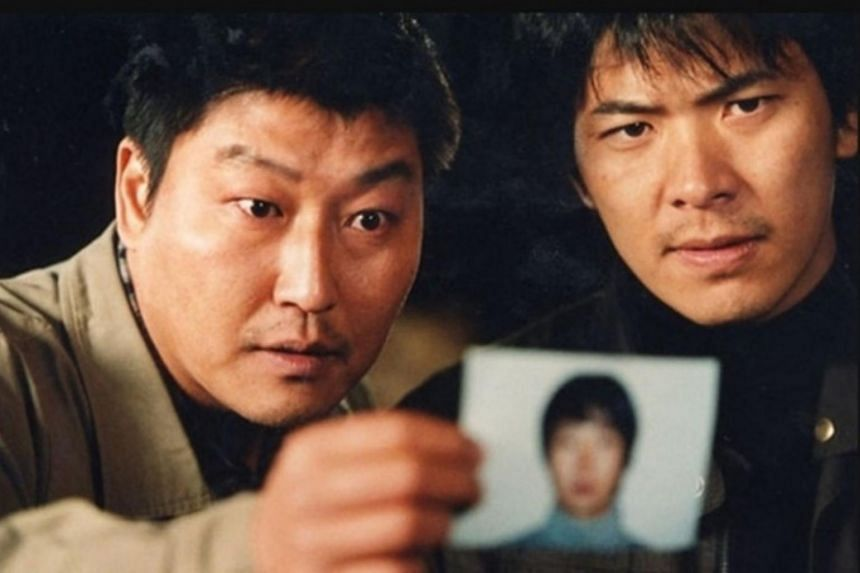 A scene from the 2003 South Korean thriller Memories of Murder, starring Bong Joon-ho (left) and Kim Sang-kyung as police officers trying to track down a serial killer on the loose.