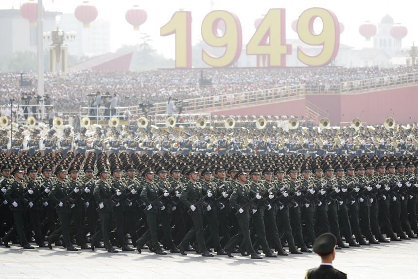 Chinese troops march past Tiananmen Square during a military parade during China's 70th anniversary celebrations in Beijing, on Oct 1, 2019.