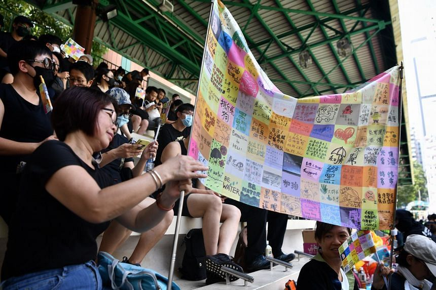 Protesters prepare a Lennon Flag at Southorn Playground which is filled with protesters.